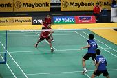 KUALA LUMPUR - JANUARY 15: Indonesia's (red) Septano/Wirawan play against Malaysia's Chan/Ong at the