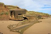 stock photo of emplacements  - ruins of a concrete war bunker on Bridlington beach - JPG