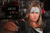 Woman In Bandanna At A Bar
