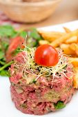 tasty tartare(Raw beef) - classic steak tartare on white plate