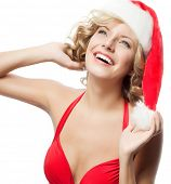 portrait of attractive  caucasian smiling woman blond isolated on white studio shot in santa's hat a