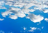 Cumulus clouds on blue sky background