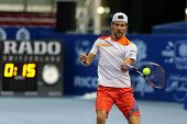 KUALA LUMPUR - SEPTEMBER 28: Jurgen Melzer drives a return to Joao Sousa in a semi-final match of th