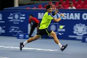 KUALA LUMPUR - SEPTEMBER 27: David Ferrer chases to hit a return to Joao Sousa in a quarter-final ma