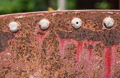 Corroded steel plate and rivet