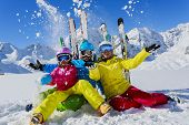 Skiing, winter, snow,  skiers, sun and fun - family enjoying winter vacations