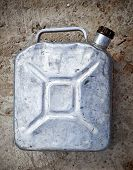 Old Gasoline Jerry Can Above Concrete Background