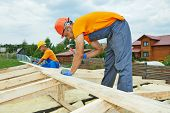 stock photo of girder  - construction carpenters workers crew on roof installation work - JPG
