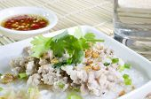 Soft-boiled Rice Pork With Glass Of Water And Fish Sauce