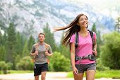 People hiking - happy hikers on hike trekking travel trek during summer vacations outdoors in beauti