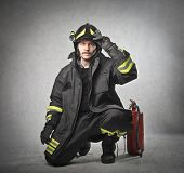 picture of firefighter  - young firefighter with the equipment - JPG
