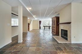 picture of stone floor  - Basement in luxury home with stone floor - JPG