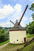 stock photo of moselle  - Medieval port crane along the banks of the Moselle in Trier - JPG