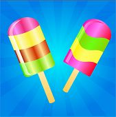 stock photo of lolli  - Two color Ice cream lollies on the blue phone with rays - JPG