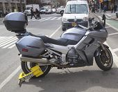 Wheel lock on an illegally parked motorcycle in Manhattan
