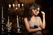 Luxury young woman in expensive interior. Young girl with flawless makeup and evening volume hairsty