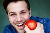 Smiling Man Holding Red Apple