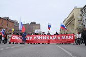 MOSCOW - MARCH 15:  demonstrators bear the poster in protection condemned for collisions with police
