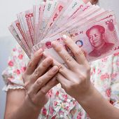 Holding RENMINBI  Chinese currency