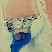 Man Shaving Using Shaving Cream Or Foam