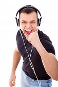 Joyful Man Listening To Music With Headphones