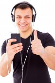 Man With Headphones Listening Music On Mp3 Player