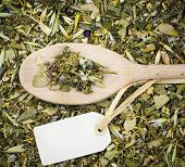 Curative natural herbal tea on wooden spoon