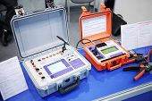 MOSCOW, RUSSIA - DEC 4, 2013: Device for control of high voltage switches and Milliohmmeter at Exhib
