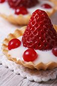 Tartlets With Strawberries, Cranberries And Cream Macro Vertical