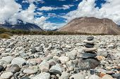 Zen balanced stones stack in Himalayas mountains. Nubra valley, Ladakh, Jammu and Kashmir, India