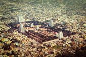 Vintage retro hipster style travel image of Hindu temple and indian city aerial view with grunge texture overlaid. Arulmigu Arunachaleswarar Temple, Tiruvannamalai, Tamil Nadu, India