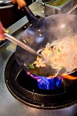 picture of chinese wok  - Preparing food in wok pan in chinese restaurant - JPG