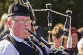Young Irish Man Playing The Bagpipe