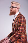 stock photo of long beard  - side view of a young fashion man with long beard and glasses looking away - JPG