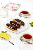 picture of eclairs  - Delicious homemade eclairs with a chocolate ganache - JPG