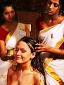 picture of panchakarma  - Young woman having head ayurveda spa treatment - JPG