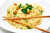 Chopsticks On Noodles And Vegetables