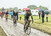The Cyclist Yukiya Arashiro On A Cobbled Road - Tour De France 2014