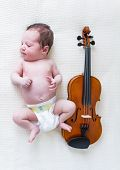 Newborn Baby And A Violin