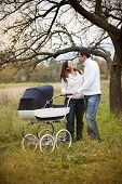 Family with vintage pram relaxing in nature