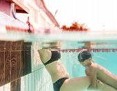 Lessons of diving. Mother and her son in swimming pool swim together