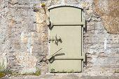Green Metal Door In Old Fortification Wall, Background Texture
