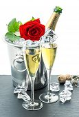 Two Glasses, Bottle Of Champagne And Red Rose Flower