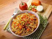 fusilli with zucchinis carrots and fresh tomatoes