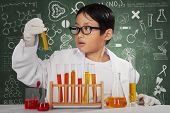 Cute Scientist Looking At Chemical Fluid