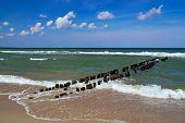 Seascape With Breakwater