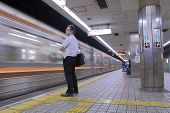 Japanese business man at Osaka subway station Japan.
