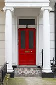 foto of victorian houses  - Red door at Victorian house with columns - JPG