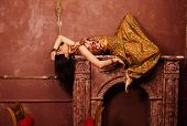 beauty sensual young woman in oriental style, luxury room