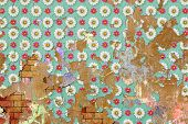 An Old Grunge Brick Wall with Flower Wallpaper Pattern